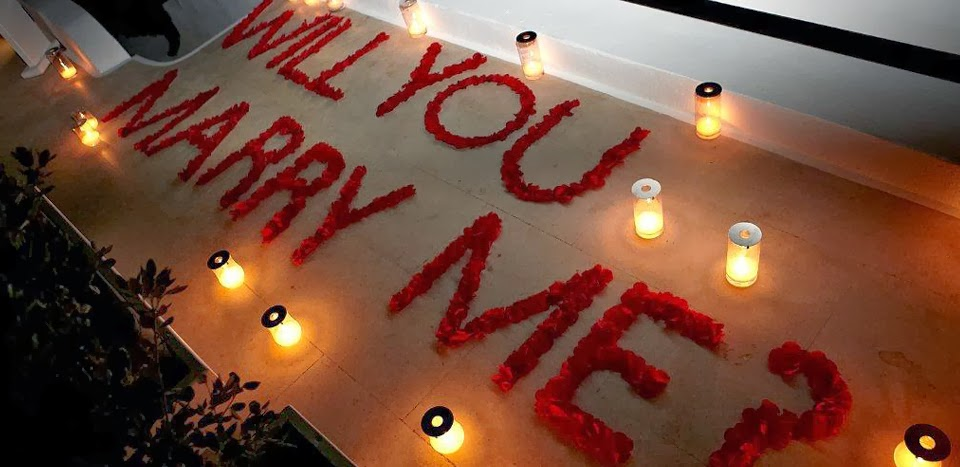 WILL YOU MARRY ME? Wedding proposal made with letters of rose petals