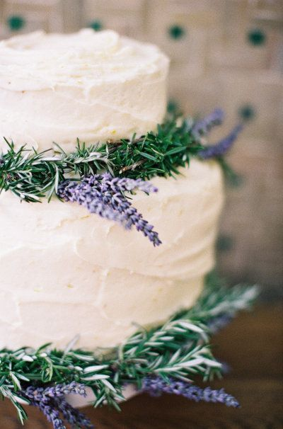 Rosemary and Lavender adorned cake. Photo by Feather and Stone Photography with Imbue Weddings florals.