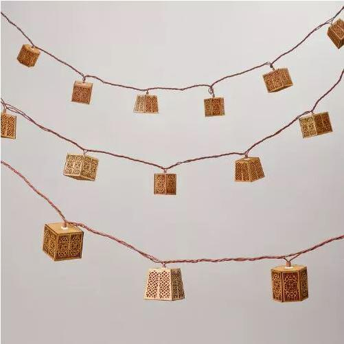 Carved Wood String Lights, $16.99 at World Market