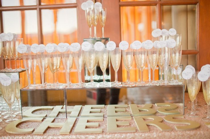wine glasses with escort cards, champagne escort cards