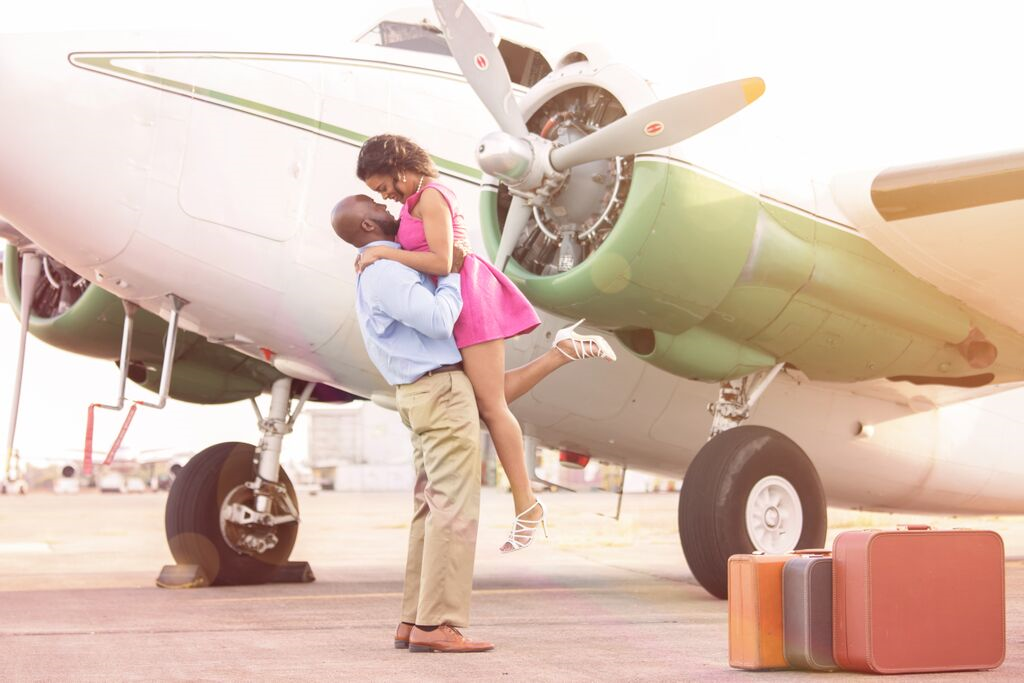 airplane travel themed engagement shoot