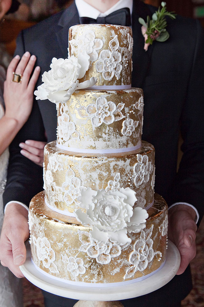 Gold cake with white flowers