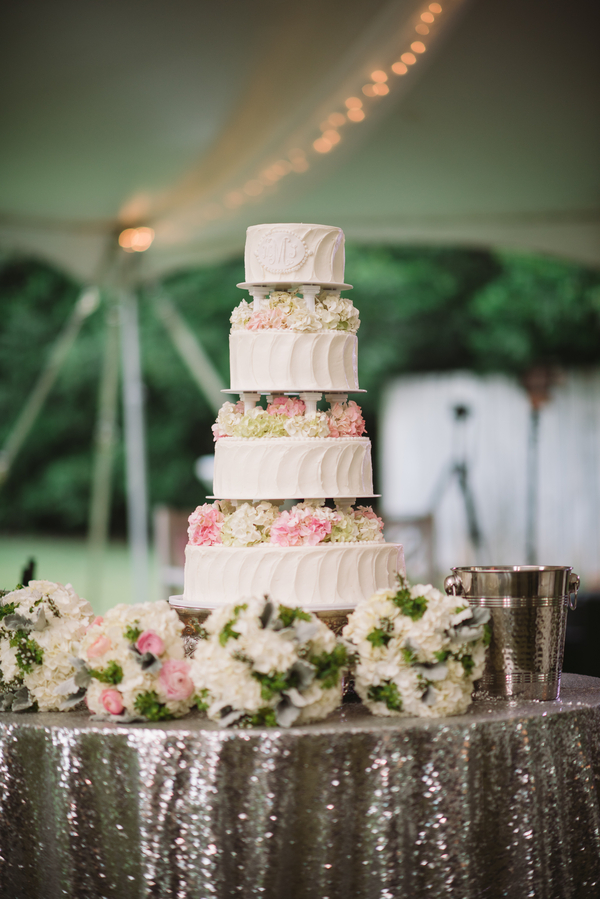 four tier wedding cake with flowers
