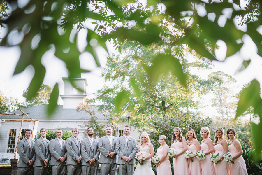 pink bridesmaids with grey groomsmen