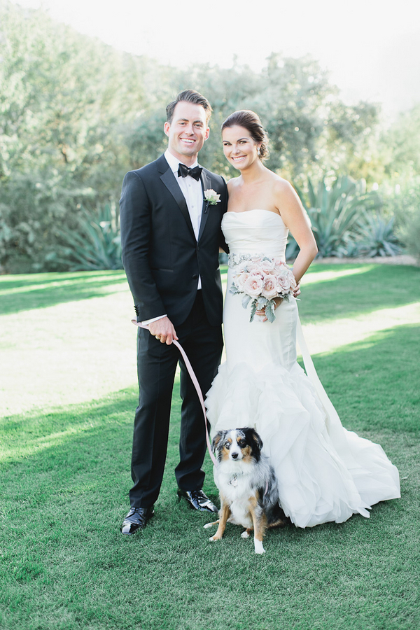 bride and groom with pet at their wedding