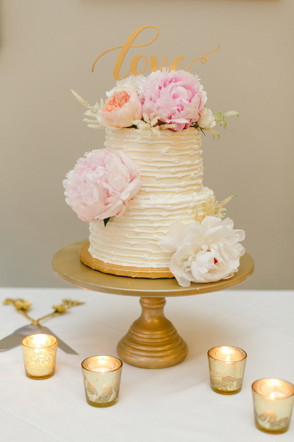two tier cake with blush peonies