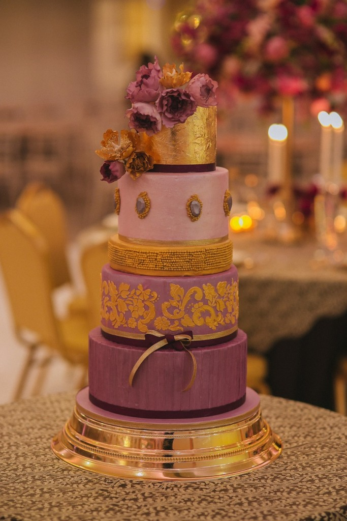purple and gold 5 tier wedding cake