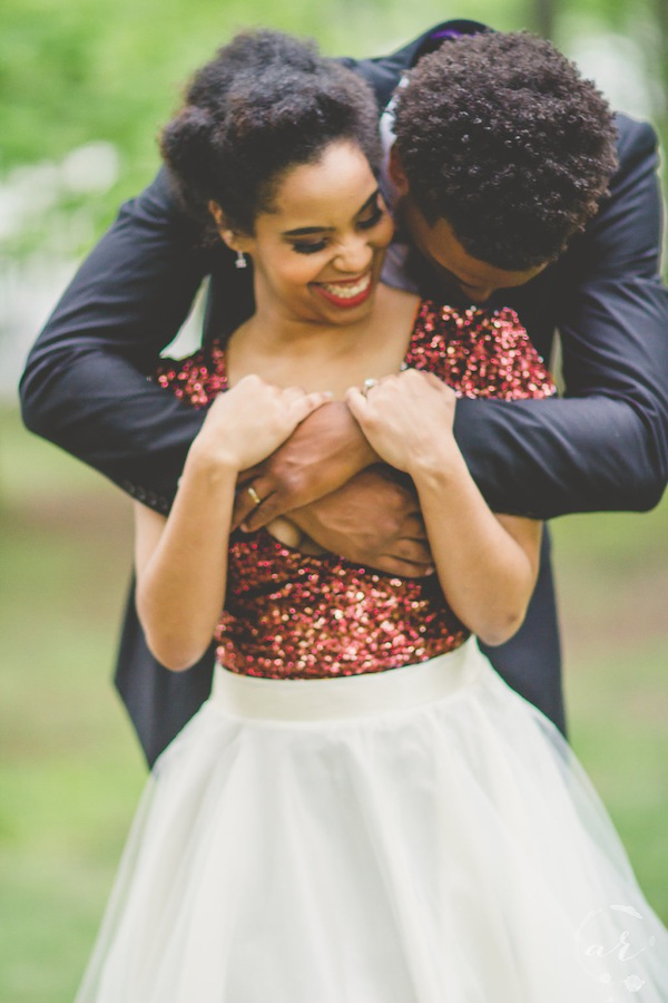 Bride wrapped in groom's arms