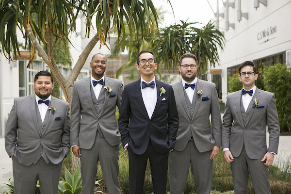 black groom suit and grey groomsmen