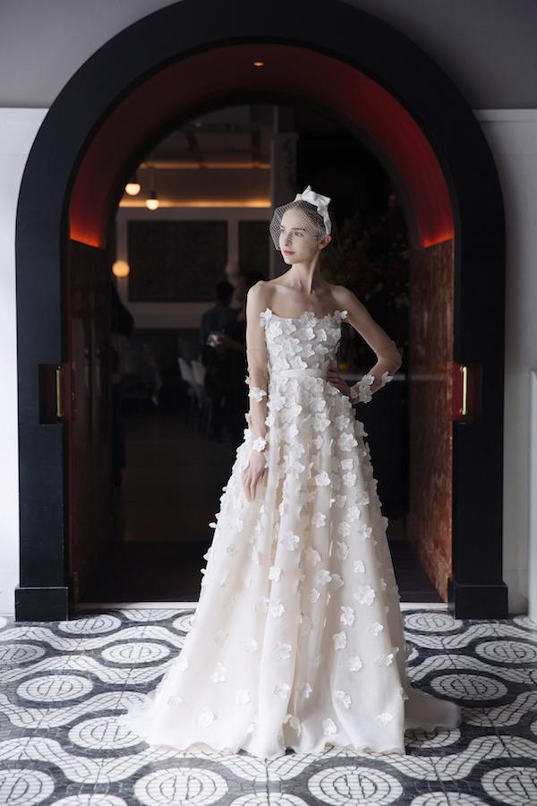 strapless applique wedding dress with birdcage veil