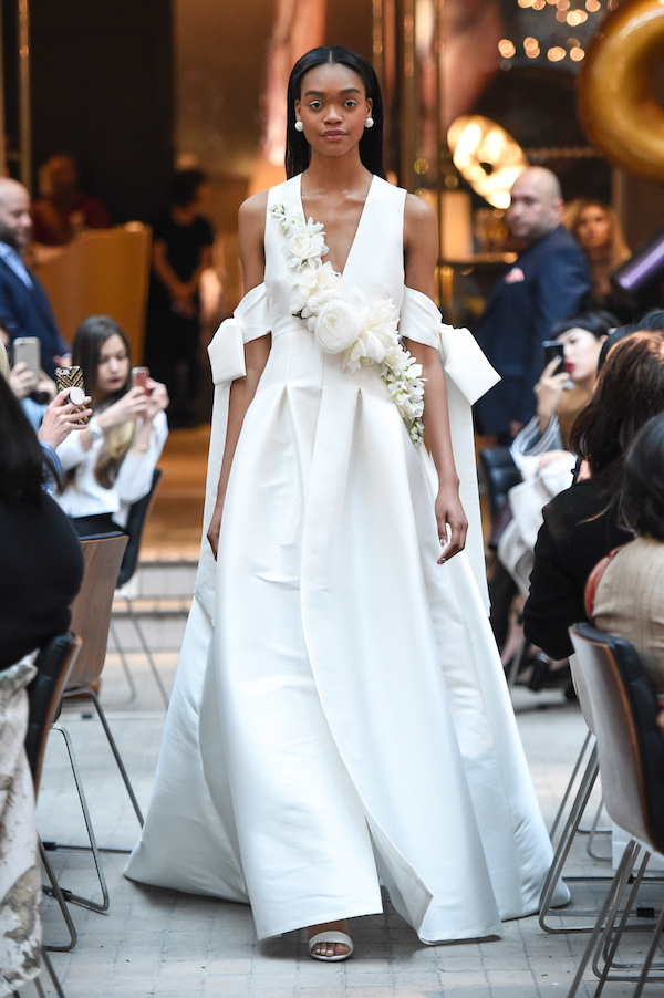 plunge v neck wedding dress with cold shoulder straps featured in bridal fashion week