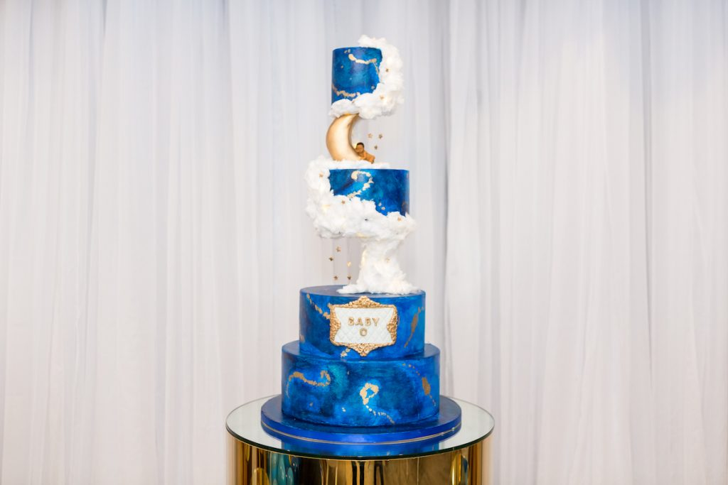 four tier over blue baby shower cake