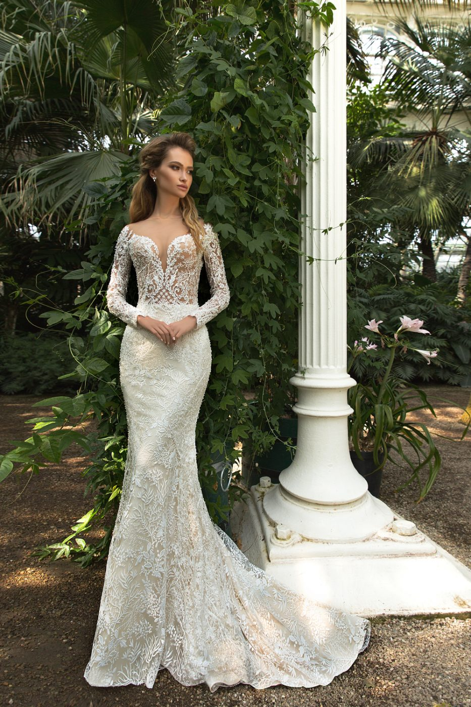 plunge neckline fit and flare wedding dress by Crystal Design Couture