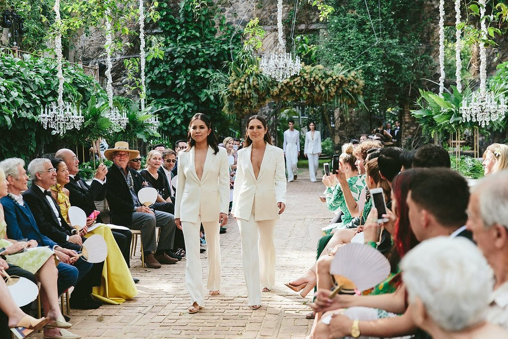 grooms ladies in white suits