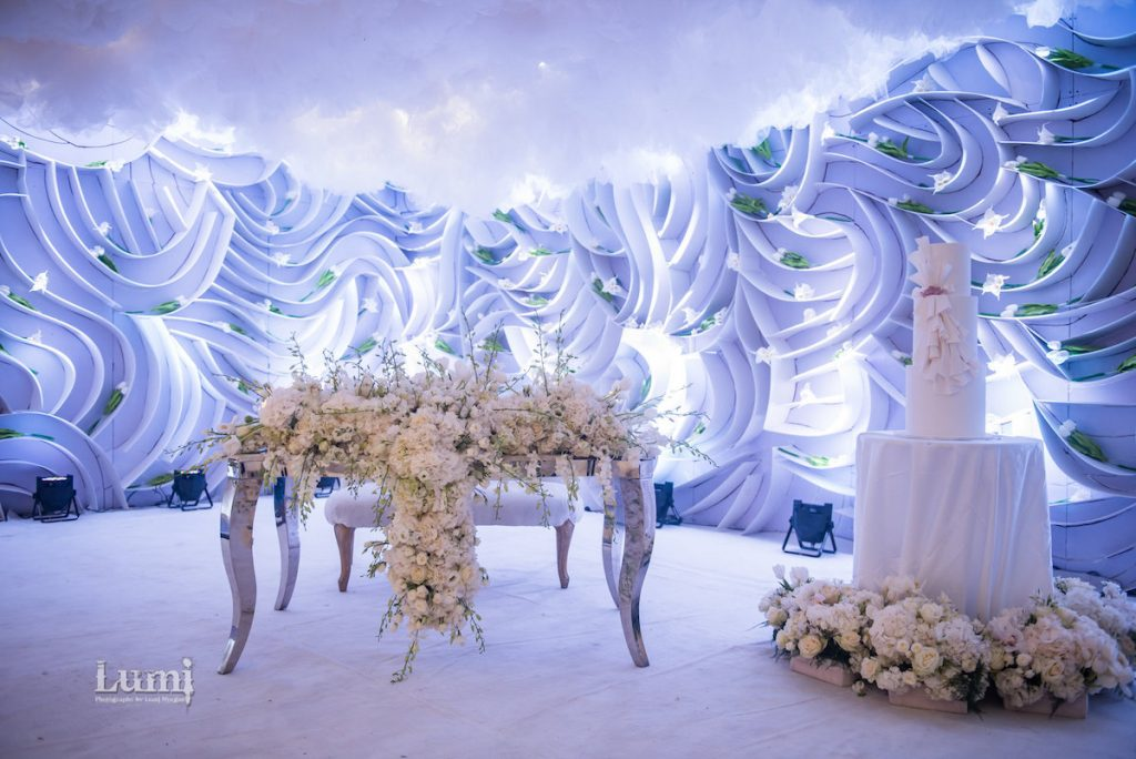 all white wedding decor with cloud installation