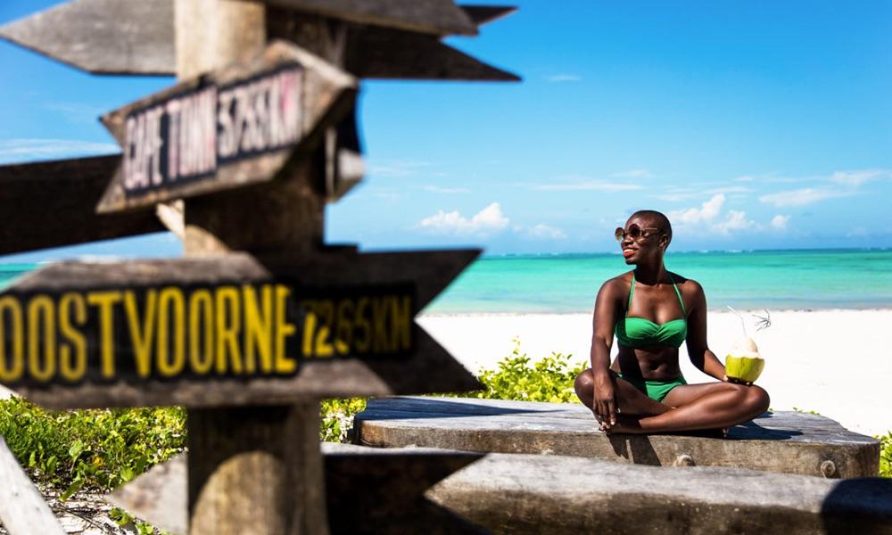 green bikini on black model travel blogger in Zanzibar