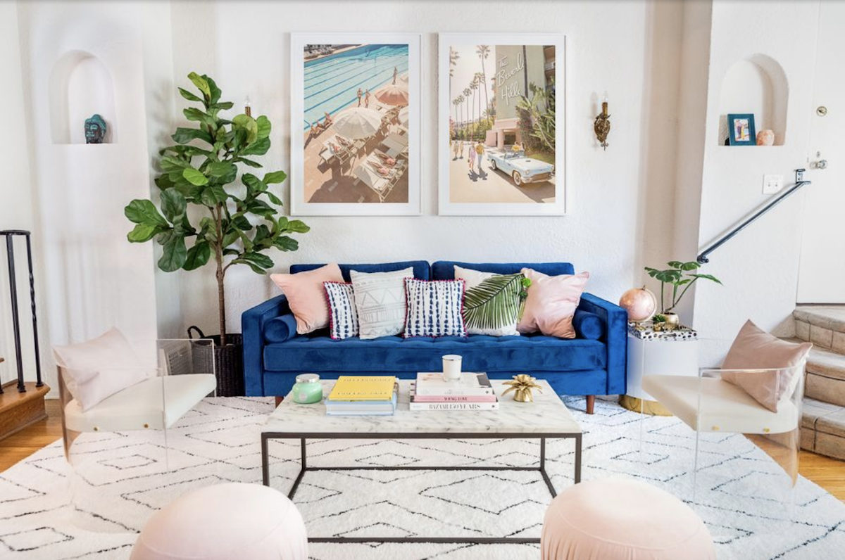 Bold Statement Pieces like this blue couch are essential to good living room decor