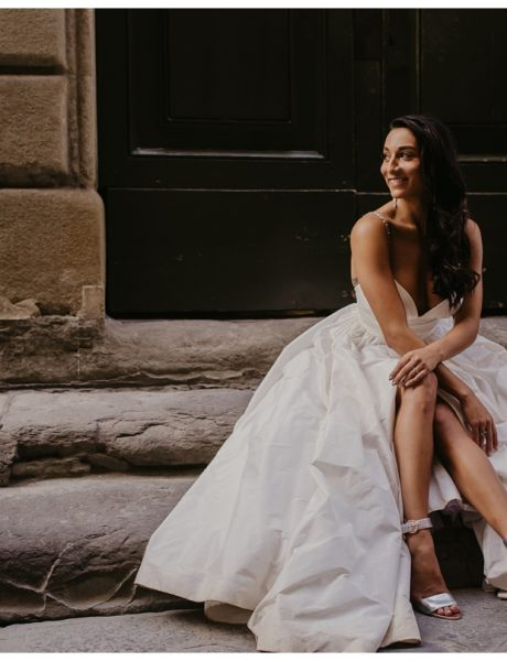 all the essentials on lea ann belter wedding dress designer by pêrfete, a virtual space for all of life's celebrations. photo of bride sitting on steps at intimate tuscan wedding