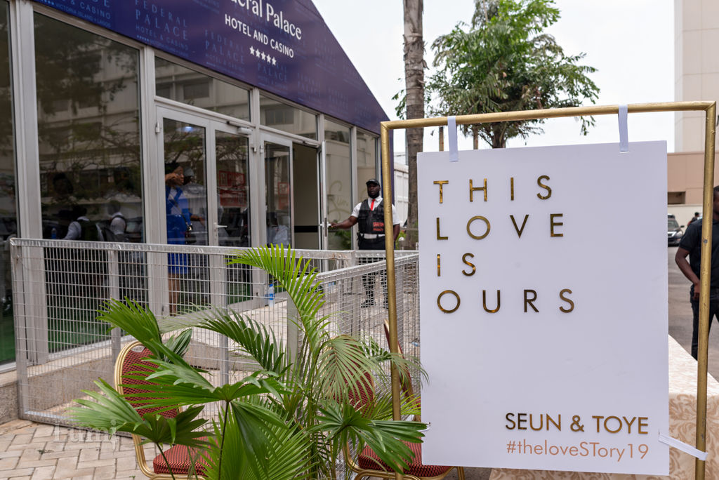 the love story this love is ours 2019 traditional nigerian wedding in lagos modern gold wedding sign outdoors