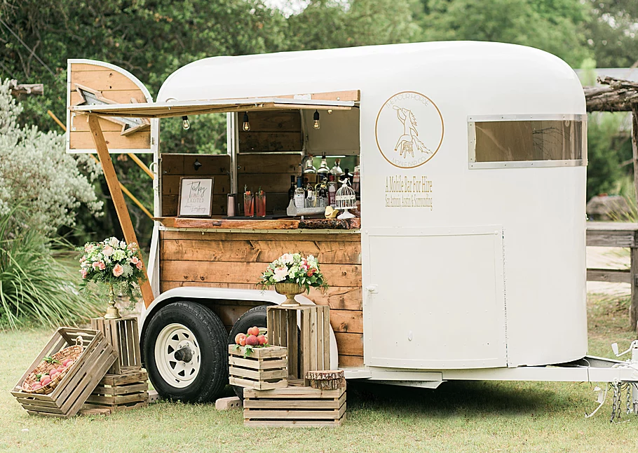 wedding trend alert: mobile bars. this converted trailer into mobile bar is the perfect accessory for your next wedding reception
