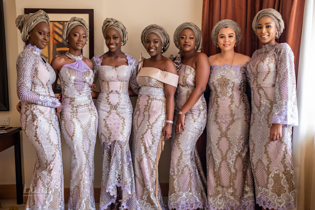 Asoebi bridesmaids in Lilac and Silver at traditional nigerian wedding in lagos. purple and silver and gold dresses
