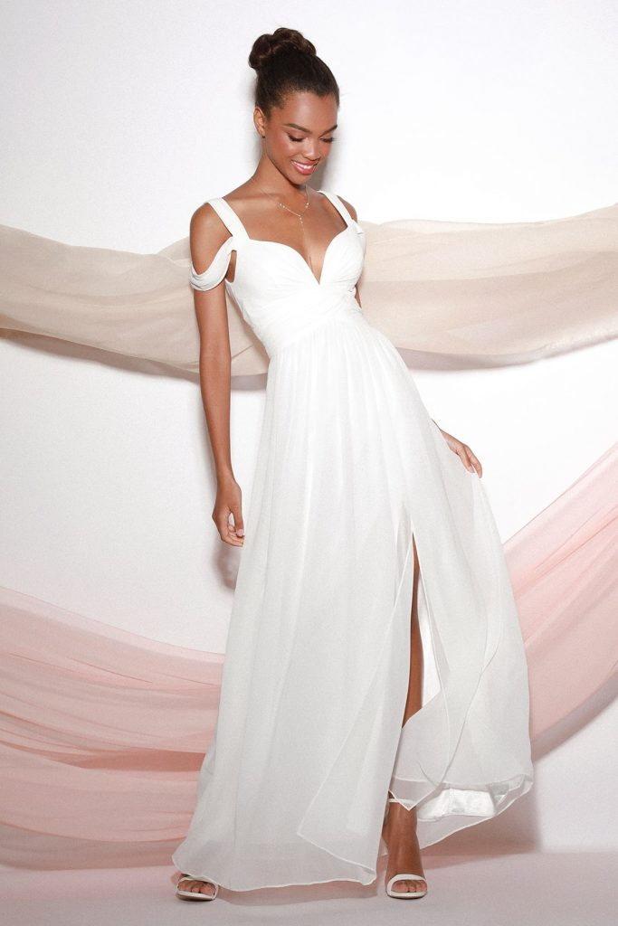 cold shoulder wedding dress in ivory with plunging neckline. chic and affordable wedding dress and wedding reception dresses perfête for your big day