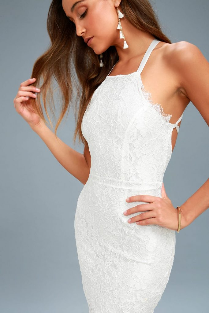 halter lace mini dress with open back in white. perfête chic and budget friendly wedding reception dresses