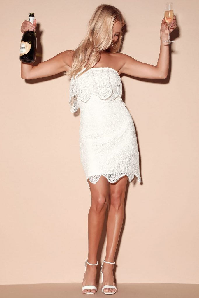 mini dress in lace with ruffle and scalloped edge hem