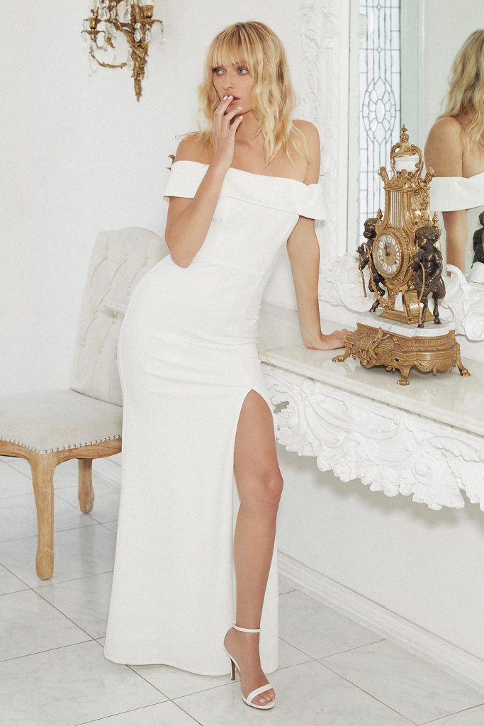 white off the shoulder evening dress with front slit.
