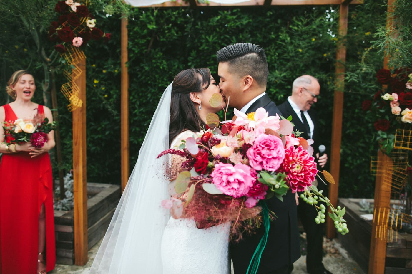 Lush red and pink fall wedding bouquet
