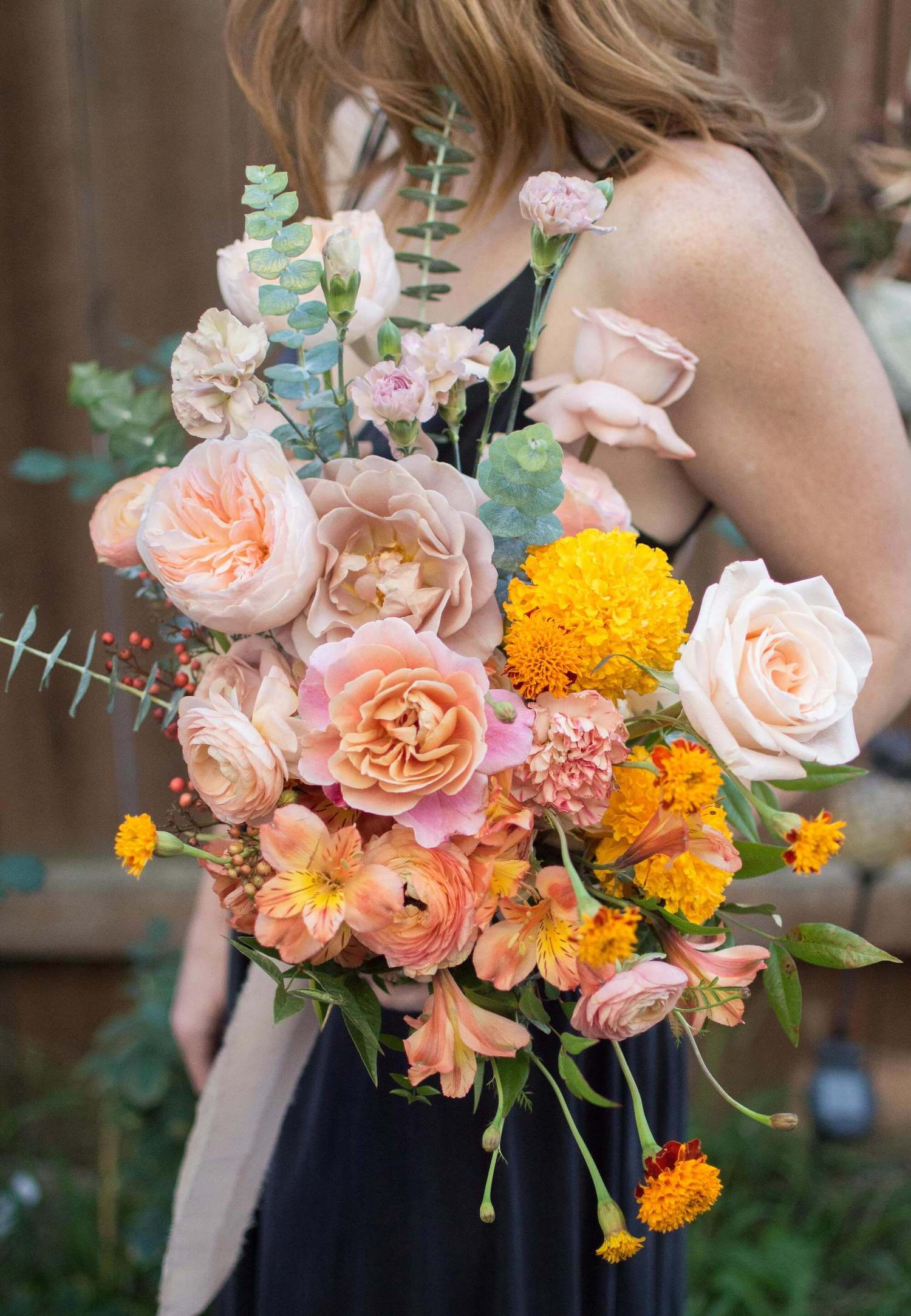 orange pink and yellow fall wedding bouquet
