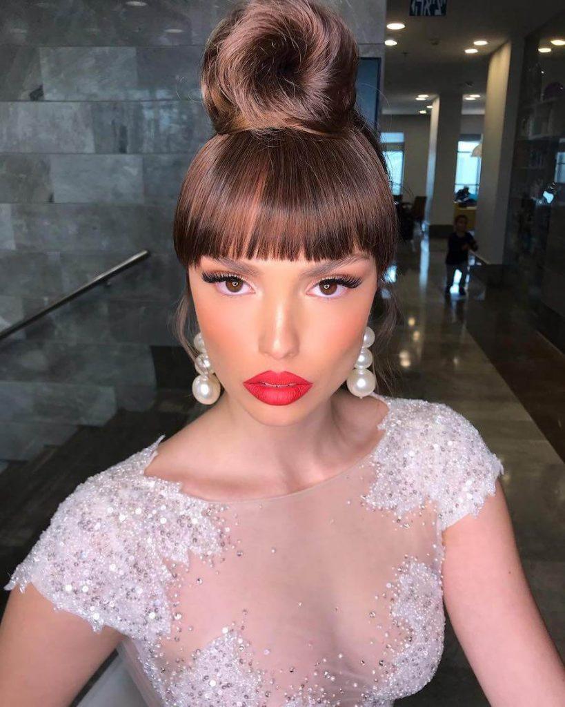 top bun bridal hairstyle with bangs