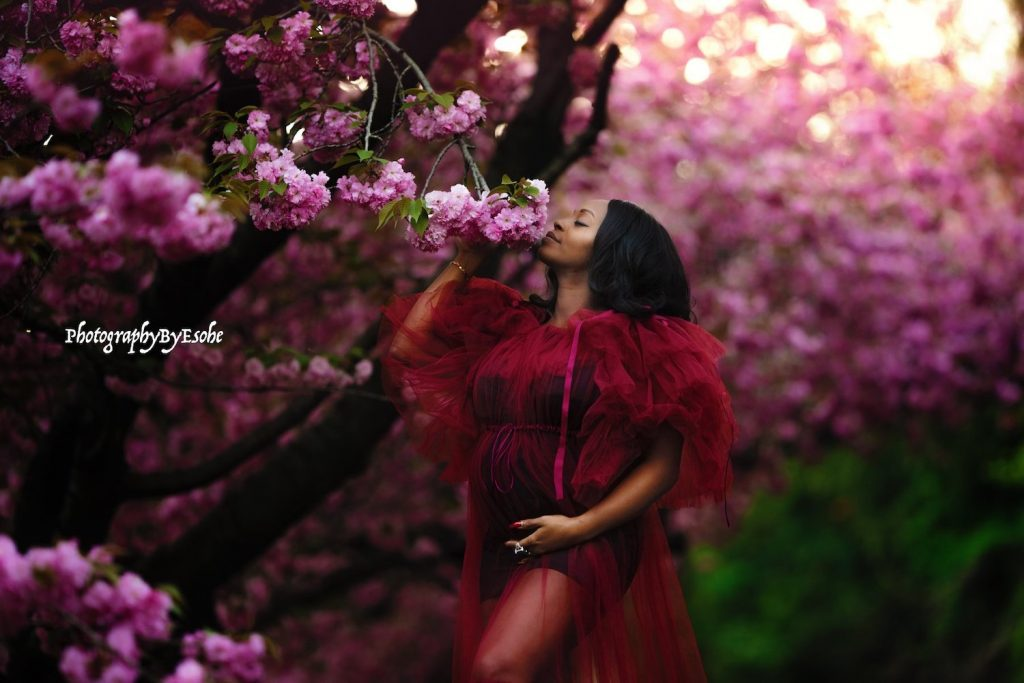 outdoor maternity shoot with red dress