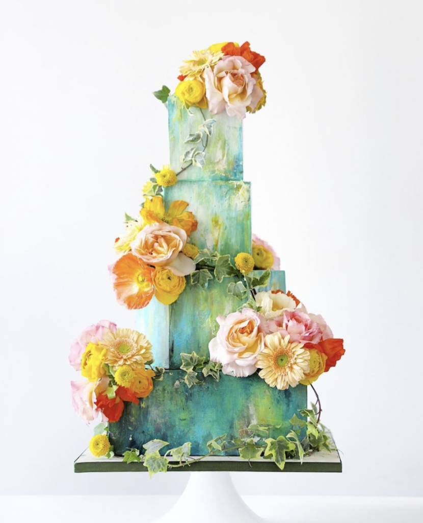 Green watercolor cake with flowers