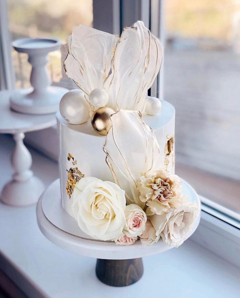 small stylish cake with flowers