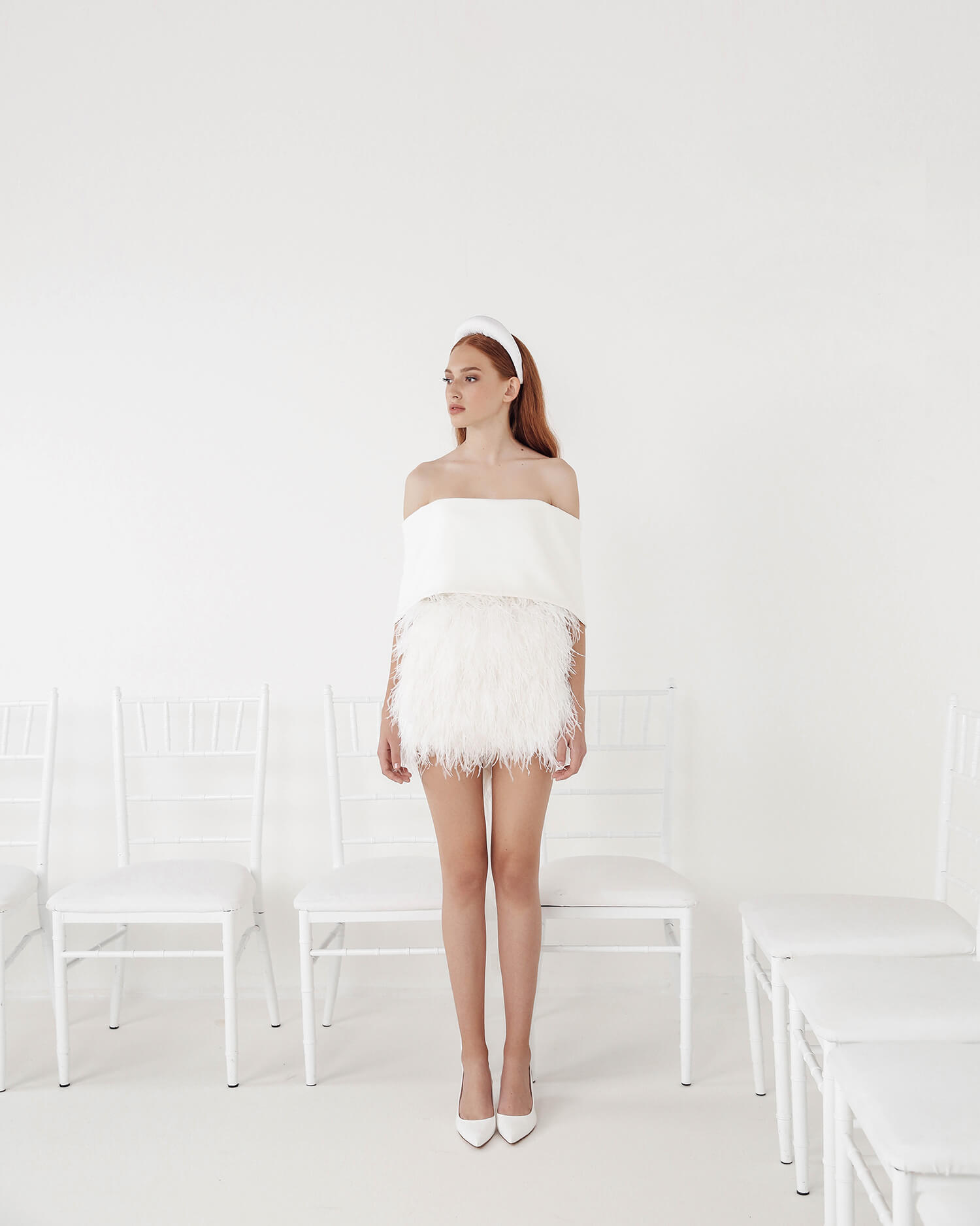 white mini dress with feather skirt wedding