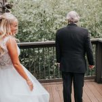 Bride wears sleeveless Hayley Paige gown as she approaches her father whose back is to her for father daughter first look moment.