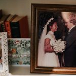 Old family wedding photos decorate book shelf