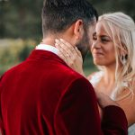 Bride and groom stare into each other's eyes for romantic wedding portrait